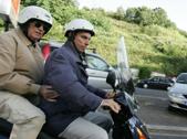 Erich Priebke (s) in motorino  con il suo avvocato Paolo Giachini, mentre si reca al lavoro nello studio del legale.(ANSA/MASSIMO PERCOSSI/PAT)